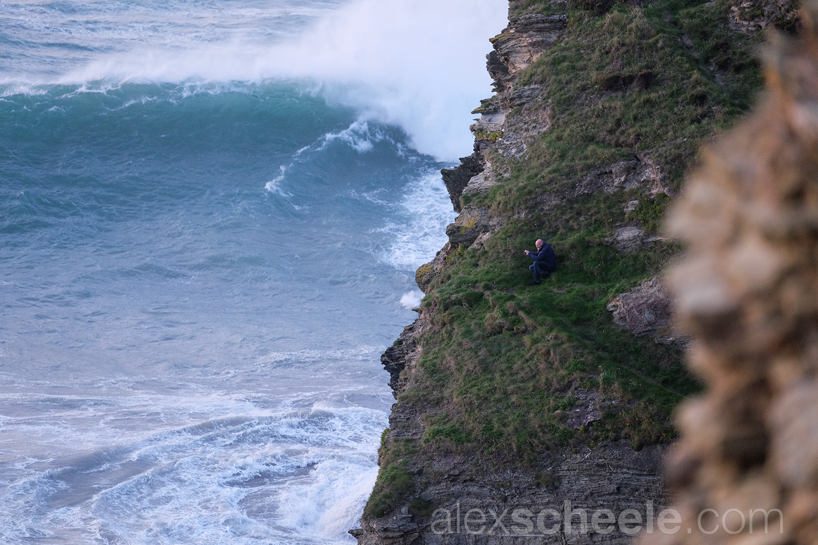 Man on cliff storm portreath